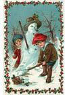 bilde barn som bygger en snømann